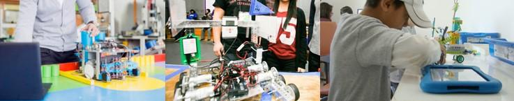 Clase de robótica para niños y alumnos practicando con coloridos robots