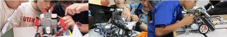 Niños ensimismados trasteando con robots recibiendo clases de robótica para niños
