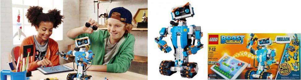 Niño y niña jugando con el robot Lego Boost, junto con la caja en la que viene