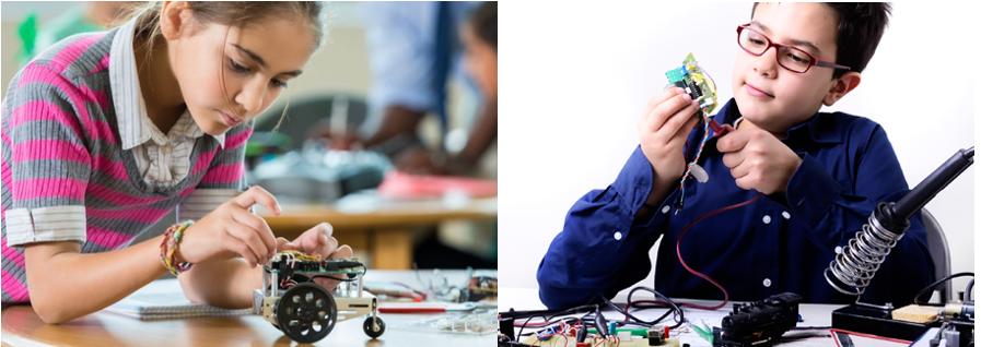 niña y niño construyendo robots
