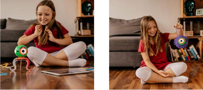 niña jugando con el robot dot y el kit de creatividad